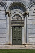 Door Of The Baptistery At The Piazza Dei Miracoli In Pisa