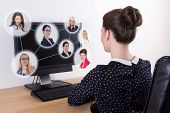 Social Network Concept - Beautiful Business Woman Using Pc With People Portraits On Screen