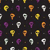 Halloween seamless pattern with skulls and bones.
