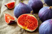 Fresh figs on fabric background