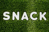 Word Snack White Wooden Alphabet On Gree Grass Background Texture
