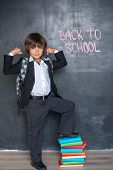 Strong cheerful school boy