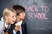 Funny picture of school boy and girl with sandwiches
