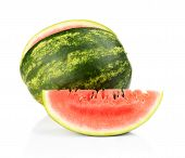 Studio Shot Whole And Slice Of Watermelon Isolated White