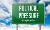 Political Pressure on Highway Signpost.