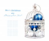 Blue And Silver Christmas Balls In Cage On The  Isolated White Background