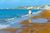 Woman And Xi Beach Morning View (greece, Kefalonia).
