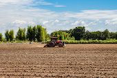 Tractor Working In Field Agriculture.