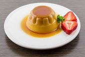 Creme Caramel Vanilla Custard Dessert Or Flan On White Dish With Strawberry