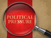 Political Pressure through Magnifying Glass.