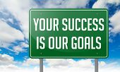 Your Success is Our Goals on Highway Signpost.