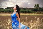 stock photo of aqueduct  - A brunette girl with an electric blue dress - JPG