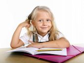 Cute  Little School Girl Playing With Her Blonde Hair Sitting Happy On Desk