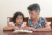 image of holy family  - Grandmother teaching the Holy Bible to her grandson - JPG