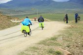 mountain bike rides along the trail on the high mountains of tibet, china