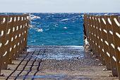 picture of trestle bridge  - Bridge on beach extended into the sea  - JPG