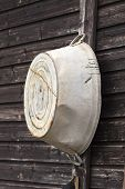 stock photo of washtub  - Old fashioned tin bath hanging up outside