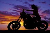 Silhouette Of A Woman On A Motorcycle Wind Blowing