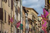 Old Houses And Flags In The Center Of Arezzo
