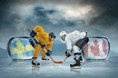 Ice hockey players on the ice. Sweeden vs Canada.
