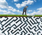Businessman looks at the underground plastic maze