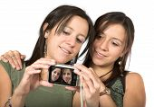 beautiful twins with digital camera