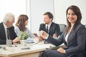 picture of assemblage  - Young pretty businesswoman during company assemblage - JPG