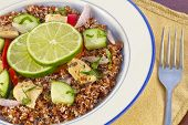 image of tabouleh  - Red Quinoa Tabbouleh salad with juicy grilled chicken and cucumbers with chopped parsley - JPG