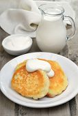 Fritters With Sour Cream And Milk Jug