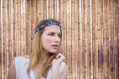 Pretty hipster blonde against wooden planks