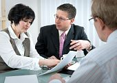 stock photo of partition  - woman and her lawyer in conversation with husband during divorce process - JPG
