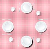 four plates on red tablecloth
