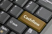 Brown cashflow key on keyboard