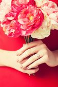 picture of fiance  - woman hands with bouquet of flowers and wedding ring - JPG