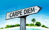 Carpe Diem sign with a beach on background