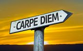 Carpe Diem sign with a sunset background