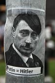 PRAGUE, CZECH REPUBLIC - MAY 24, 2014: Sticker depicting Russian president Vladimir Putin as Adolf Hitler and with an equals sign between their names seen in Prague, Czech Republic.