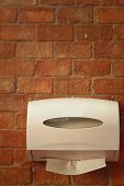 Tissue Box On A Background Of A Brick.
