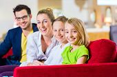 Family selecting together sofa in home center to furniture store