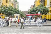 LIMA, PERU, MAY 23, 2014: Horse drawn carriage waits for tourists in Plaza Mayor
