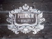 Vintage Styled Premium Quality Label on the wood background. Vector.