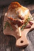 stock photo of lamb  - lamb leg on board - JPG