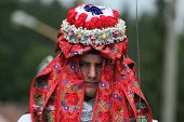 VLCNOV, CZECH REPUBLIC - MAY 26, 2013: Young men dressed in traditional Moravian folk costume performs the Pageboy during the Ride of the Kings festival in Vlcnov, South Moravia, Czech Republic.