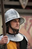 MILOVICE, CZECH REPUBLIC - OCTOBER 23, 2013: Background actor dressed as a medieval guard attends the filming of the new movie The Knights directed by Carsten Gutschmidt near Milovice, Czech Republic.