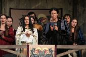 MILOVICE, CZECH REPUBLIC - OCTOBER 23, 2013: Background actors dressed as medieval nobles attend the filming of the new movie The Knights directed by Carsten Gutschmidt near Milovice, Czech Republic.