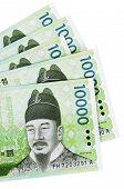 image of won  - Several Korean 10000 Won currency bills isolated on a white background - JPG