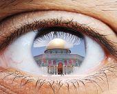 Closeup of human eye, macro mode with double exposure and Masjid al-Aqsa mosque in Jerusalem