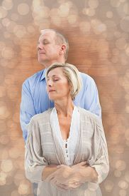 picture of male pattern baldness  - Happy mature couple embracing with eyes closed against light glowing dots design pattern - JPG