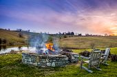 picture of bonfire  - Bonfire in a fire pit at sunset in Central Kentucky countryside - JPG