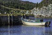 pic of dory  - A small fishing boat tied up at the wharf in rural Newfoundland - JPG